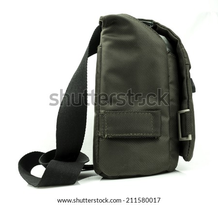 A small dark green sling bag on white background - stock photo