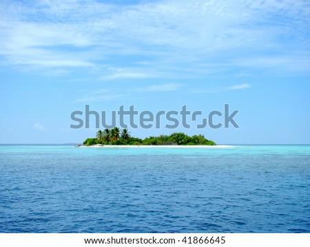 A small desert island at the Maldives - stock photo