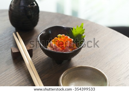 a small dish of Salmon roe, and tuna served as an appitizer before the main meal - stock photo