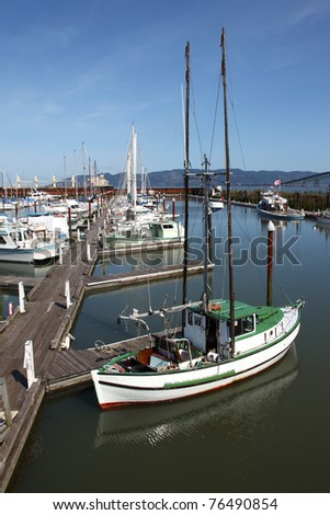 A small fishing boat with outriggers, Astoria OR. - stock photo
