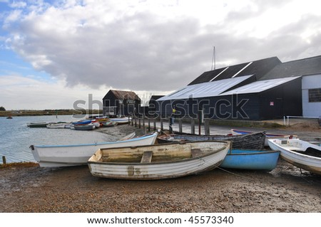 A small fishing harbour on the Thames Estuary in Essex, United Kingdom - stock photo