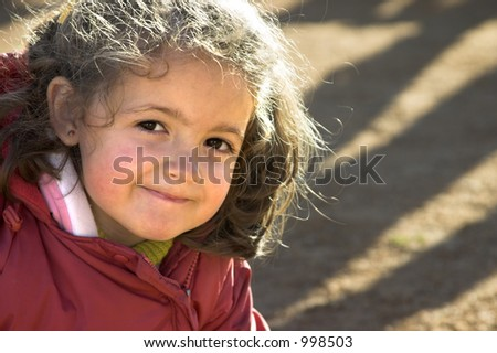 A small girl smiling. - stock photo