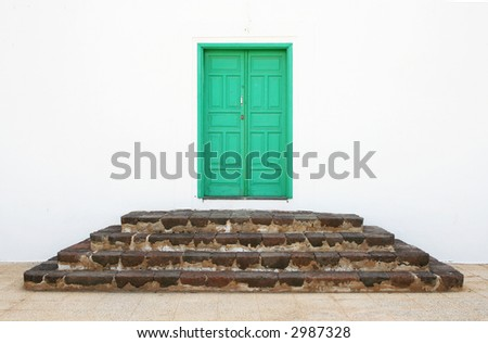 A small green door to a monastery in Teguise, Lanzarote - stock photo