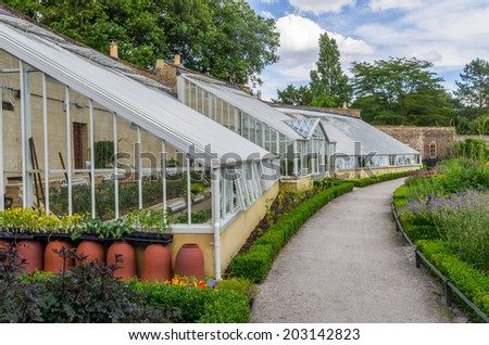 A small greenhouse in the botanical garden - stock photo