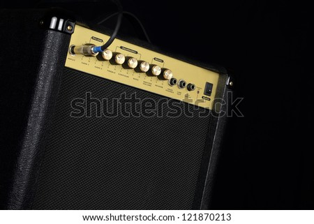 A small guitar amplifier on black background - stock photo