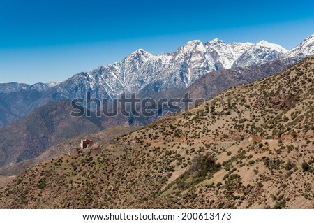A small hotel by a narrow road high in the Atlas Mountains in Morocco. - stock photo