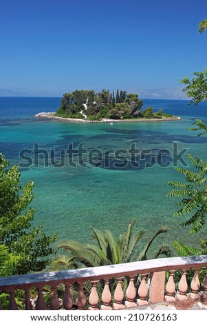 A small island in Mediterranean sea. Pontikonisi, Corfu, Greece - stock photo