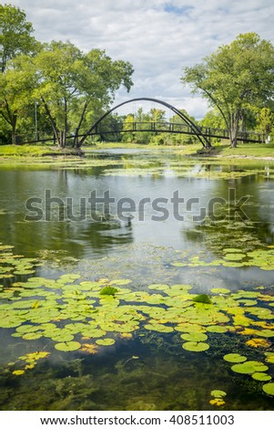 A small pond and bridge in Madison, Wisconsin - stock photo