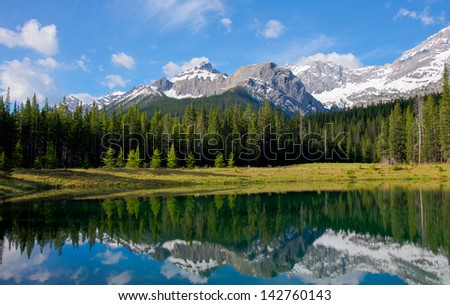 A small pond with stunning view. Kananaskis Country, Alberta,Canada. - stock photo
