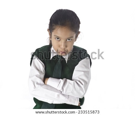 A small school girl unhappy to get ready at morning time  - stock photo