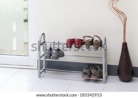 A small shoe shelf with women shoes - stock photo