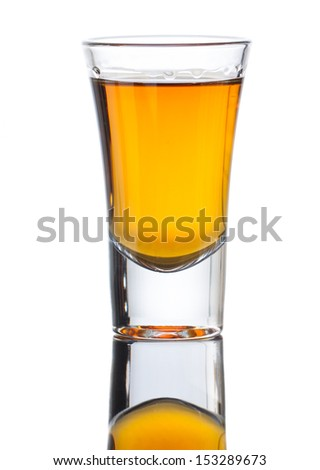 A small shot glass of delicious single malt whiskey with reflection . Isolated on white - stock photo