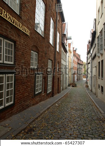 A small street in Lubeck, Germany - stock photo