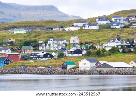 A small village on one of the Faroe Islands. The gloomy weather. - stock photo