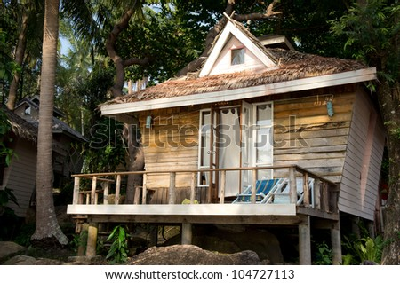 A small wooden house at the resort - stock photo