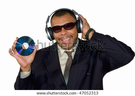 a smiling African-American mature man with sunglasses and headphones presenting an audio compact disk, isolated on white background - stock photo