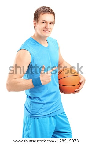 A smiling basketball player holding a ball and gesturing isolated on white background - stock photo