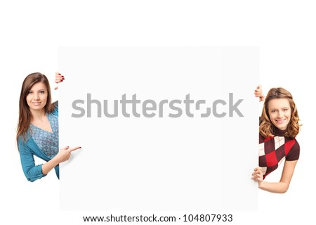 A smiling beautiful women posing with a white panel isolated on white background - stock photo