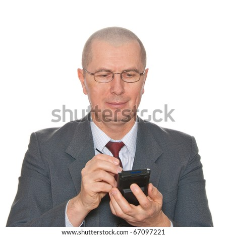 A smiling businessman with pda isolated on white. - stock photo
