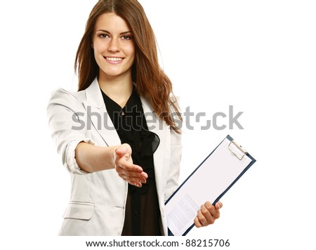 A smiling businesswoman offering a handshake, isolated on white - stock photo