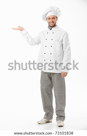A smiling cook shows his hand on a white background - stock photo