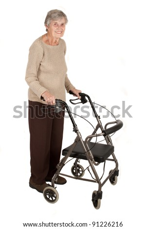 A smiling elderly woman standing with her walker isolated on white background - stock photo