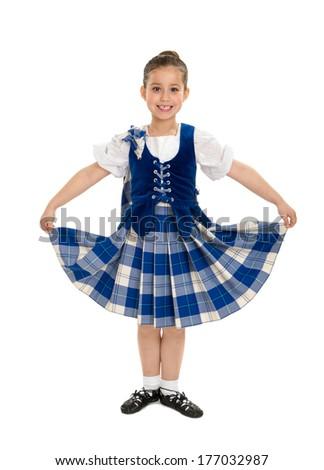 A Smiling Irish Highland Dancer in Celtic Tartan - stock photo