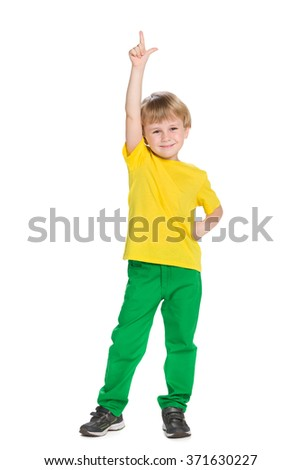 A smiling little boy shows his finger up - stock photo