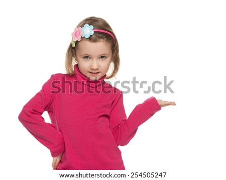 A smiling little girl makes a hand gesture against the white background - stock photo