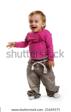 a smiling little girl on white background - stock photo