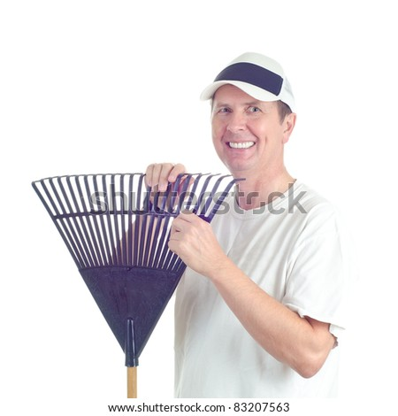 A smiling male in hat with a garden rake isolated on white. - stock photo