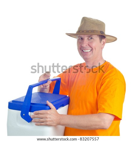 A smiling male in hat with a picnic handheld refrigerator. Isolated on white. - stock photo