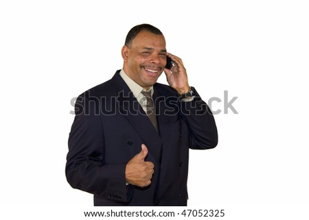a smiling mature African-American businessman with a cell phone posing with the thumbs up sign, isolated on white background - stock photo