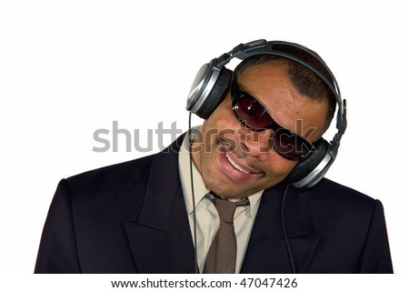 a smiling mature African-American man with sunglasses and headphones bending his head, isolated on white background - stock photo