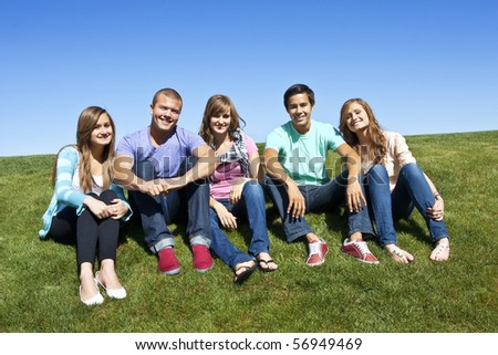 A smiling Multi-racial group of Young Adults - stock photo