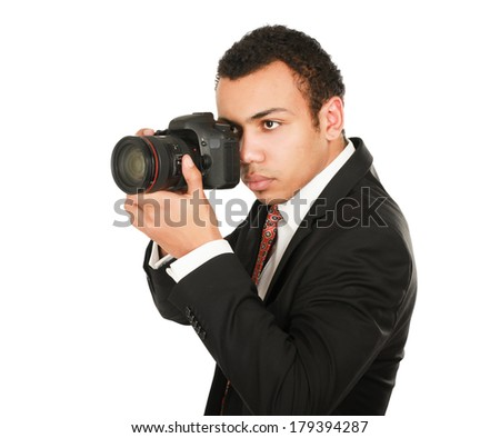 A smiling professional photographer - stock photo