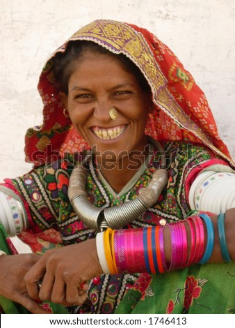 a smiling tribal woman in a village in india - stock photo