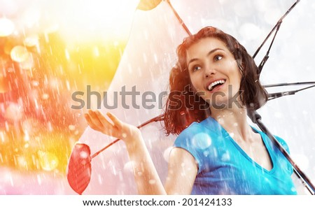 a smiling woman happy rain - stock photo