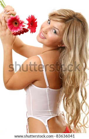 A smiling woman with a flower - stock photo