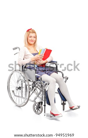 A smiling young girl in a wheelchair isolated on white background - stock photo