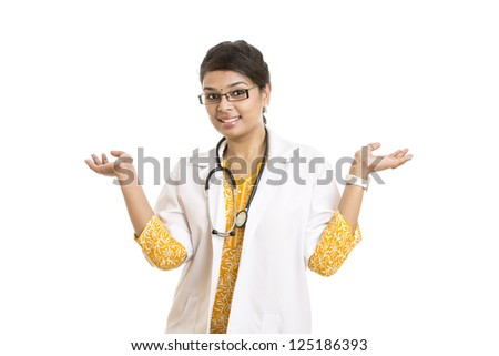 A smiling young Indian Female Doctor welcoming on white. - stock photo