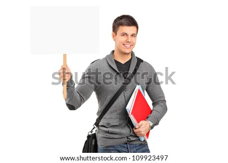A smiling young student holding a blank banner isolated against white background - stock photo