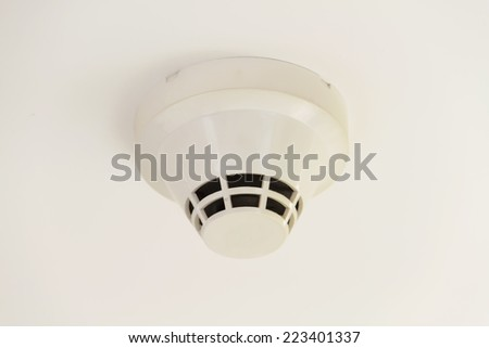 A smoke detector fire alarm - stock photo
