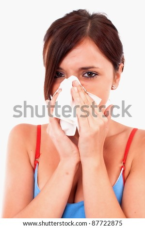 A sneezing woman isolated on white - stock photo