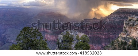 A snow squall swirls in the Grand Canyon and sunset, seen from Mather Point in Grand Canyon National Park, Arizona. - stock photo