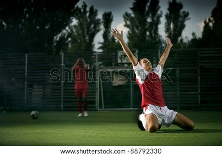 a soccer player on the grass field - stock photo