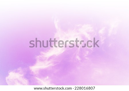 A soft cloud background with a pastel colored orange to blue gradient - stock photo