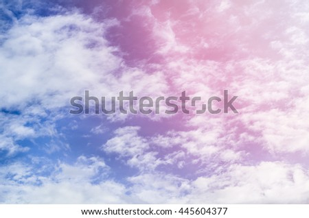 A soft cloud background with a pastel colored orange to blue gradient,sky and clouds with gradient filter, nature abstract background - stock photo