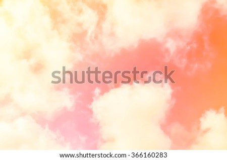 A soft cloud background with a pastel colored orange to pink - stock photo