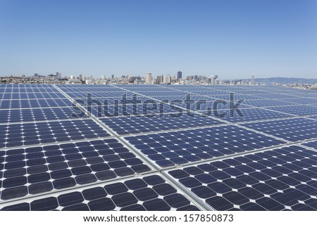 A solar panels on the rooftop of the building with San Francisco skyline in the background. - stock photo